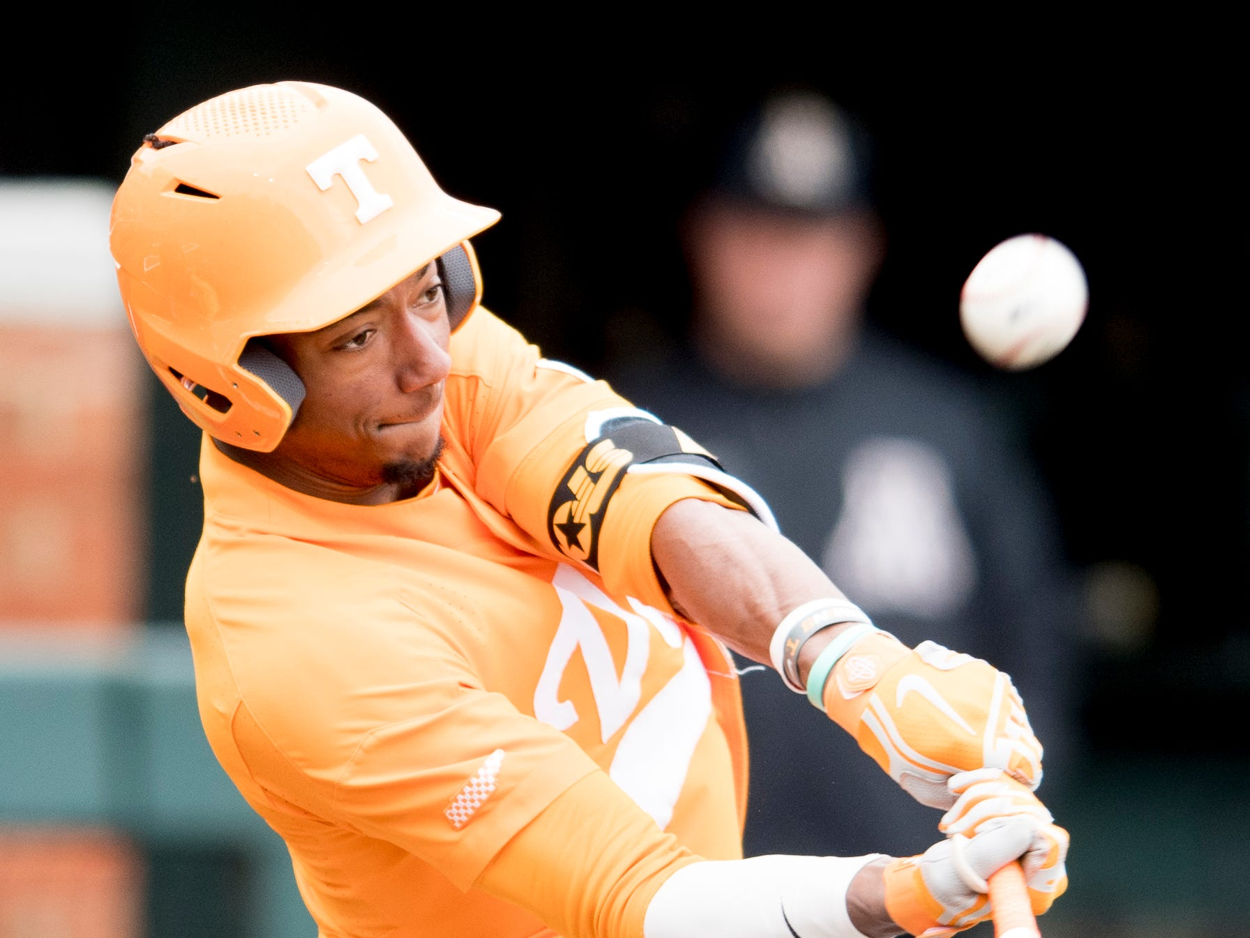 Tennessee outfielder/infielder Jay Charleston (4) hits the ball during a Tennessee baseball home opener game against Appalachian State at Lindsey Nelson Stadium in Knoxville, Tennessee on Saturday, February 16, 2019.