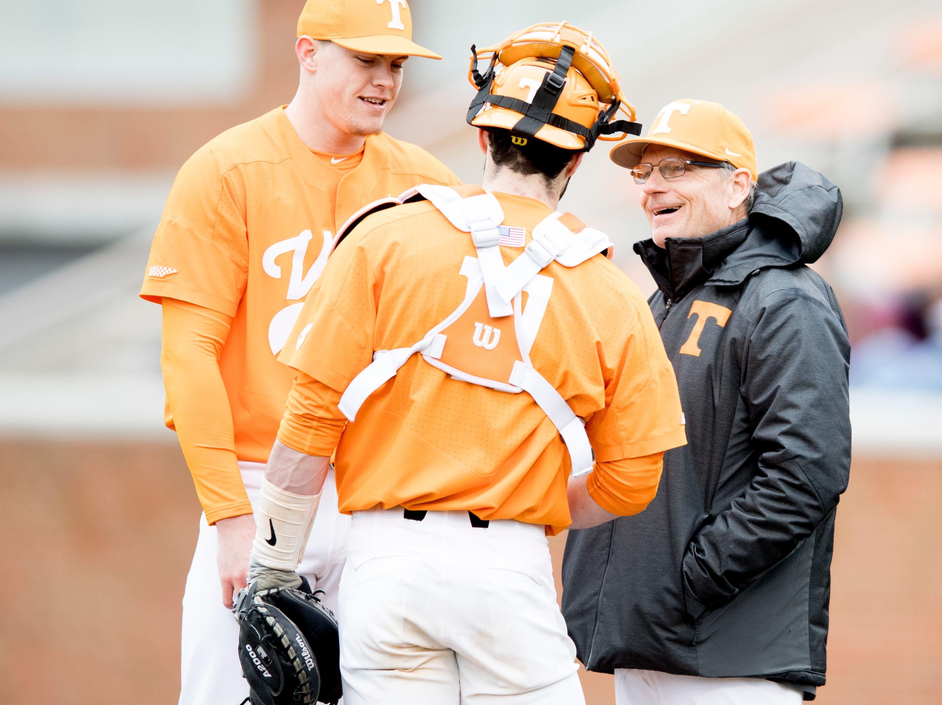 Tennessee Assistant Coach Frank Anderson speaks with Tennessee catcher Connor Pavolony (17) and Tennessee pitcher Zach Linginfelter (25) at the pitchers mound during a Tennessee baseball home opener game against Appalachian State at Lindsey Nelson Stadium in Knoxville, Tennessee on Saturday, February 16, 2019.
