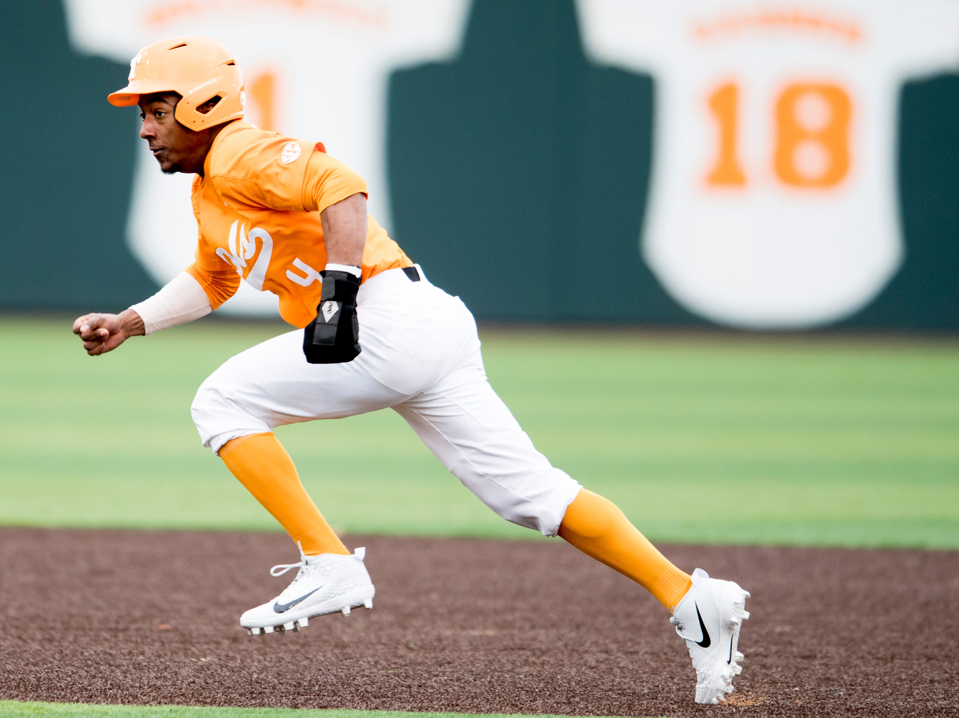 Tennessee outfielder/infielder Jay Charleston (4) runs toward third base during a Tennessee baseball home opener game against Appalachian State at Lindsey Nelson Stadium in Knoxville, Tennessee on Saturday, February 16, 2019.