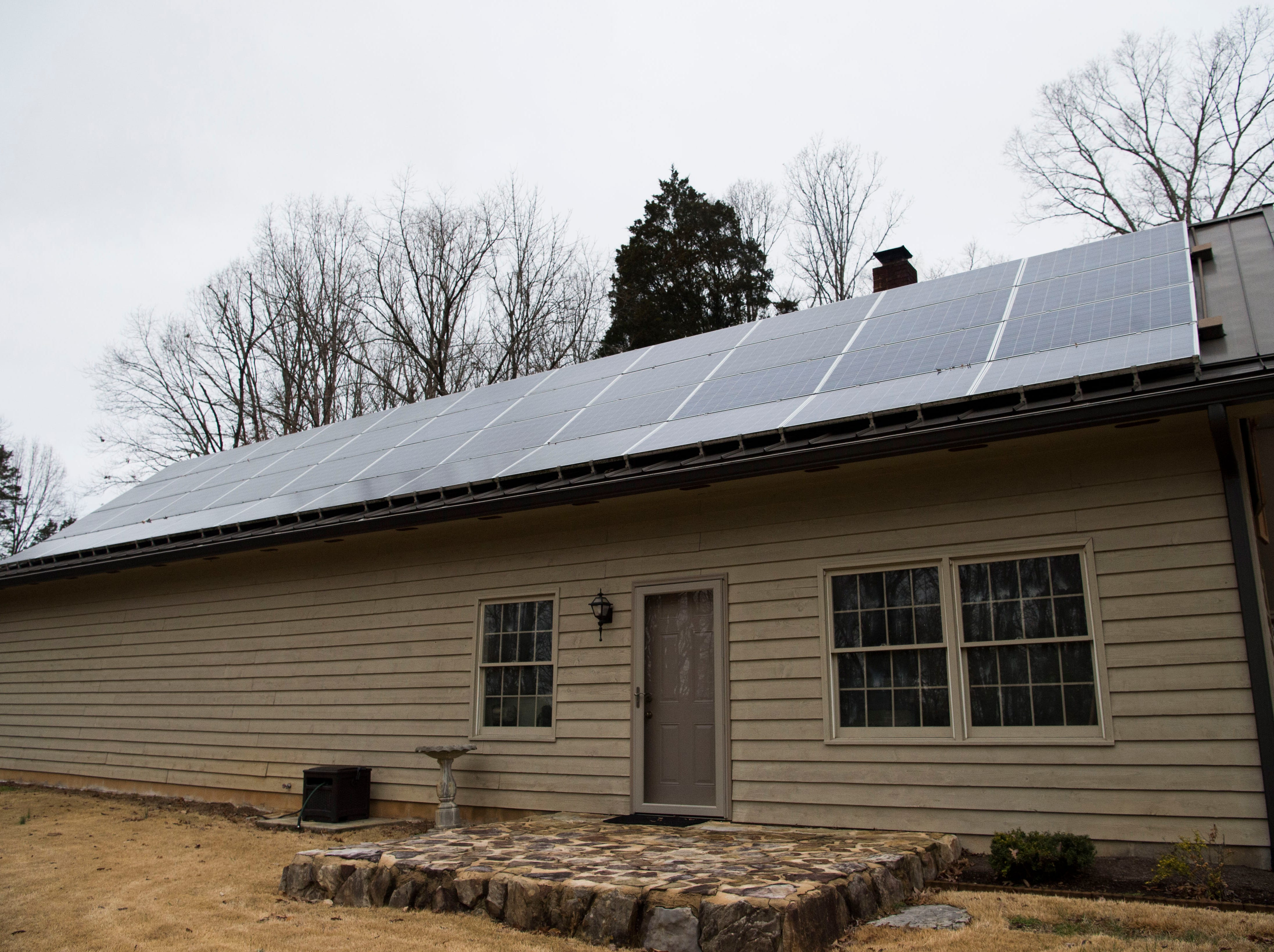 Mark Bishop has solar panels at his home which help charge his electric vehicles, in Clinton, Saturday, Feb. 16, 2019.