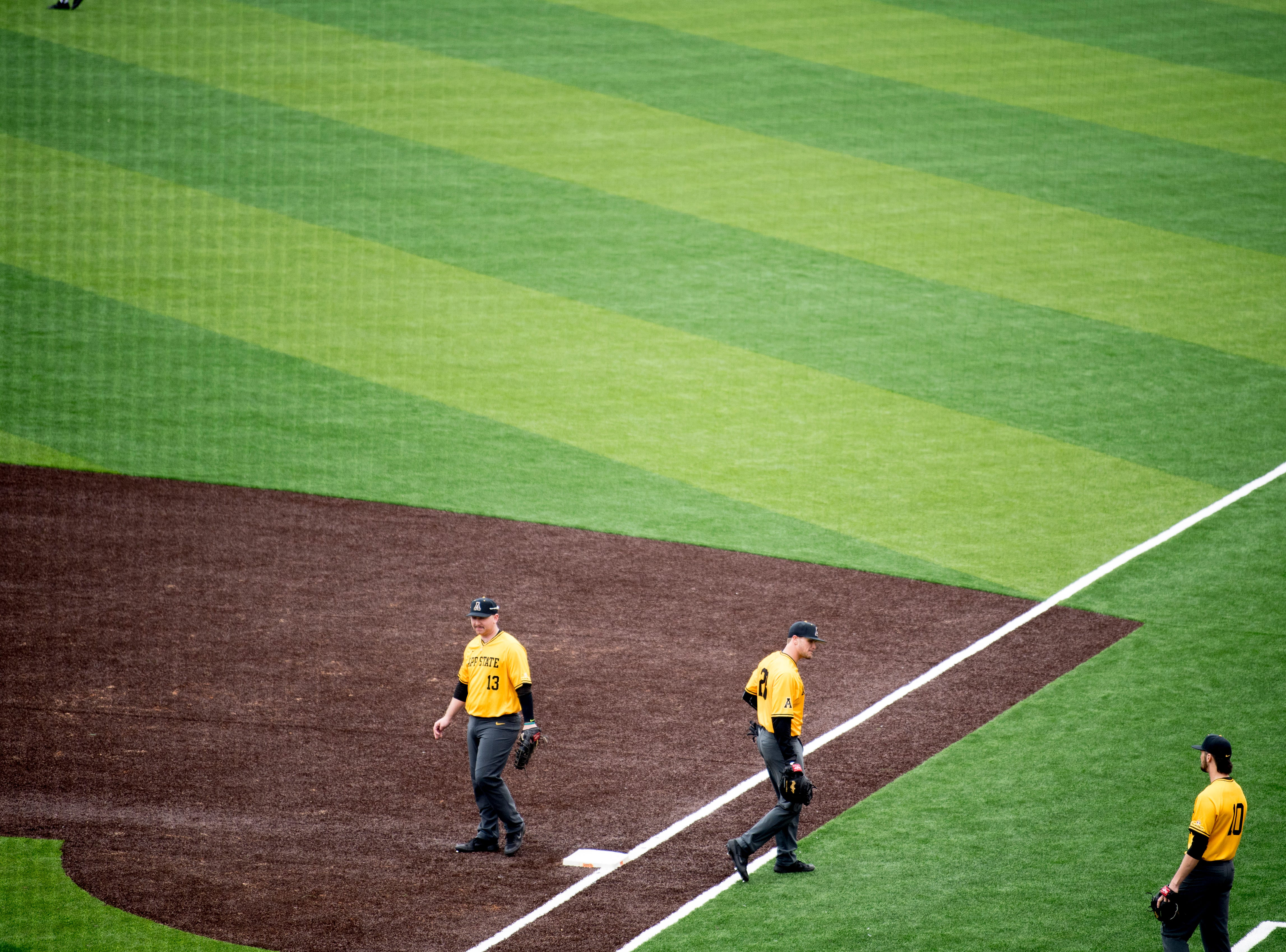 Appalachian State players warm up on the all-new turf field at Lindsey Nelson Stadium in Knoxville, Tennessee on Saturday, February 16, 2019. The pitchers mound is the only part of the field that remains dirt.