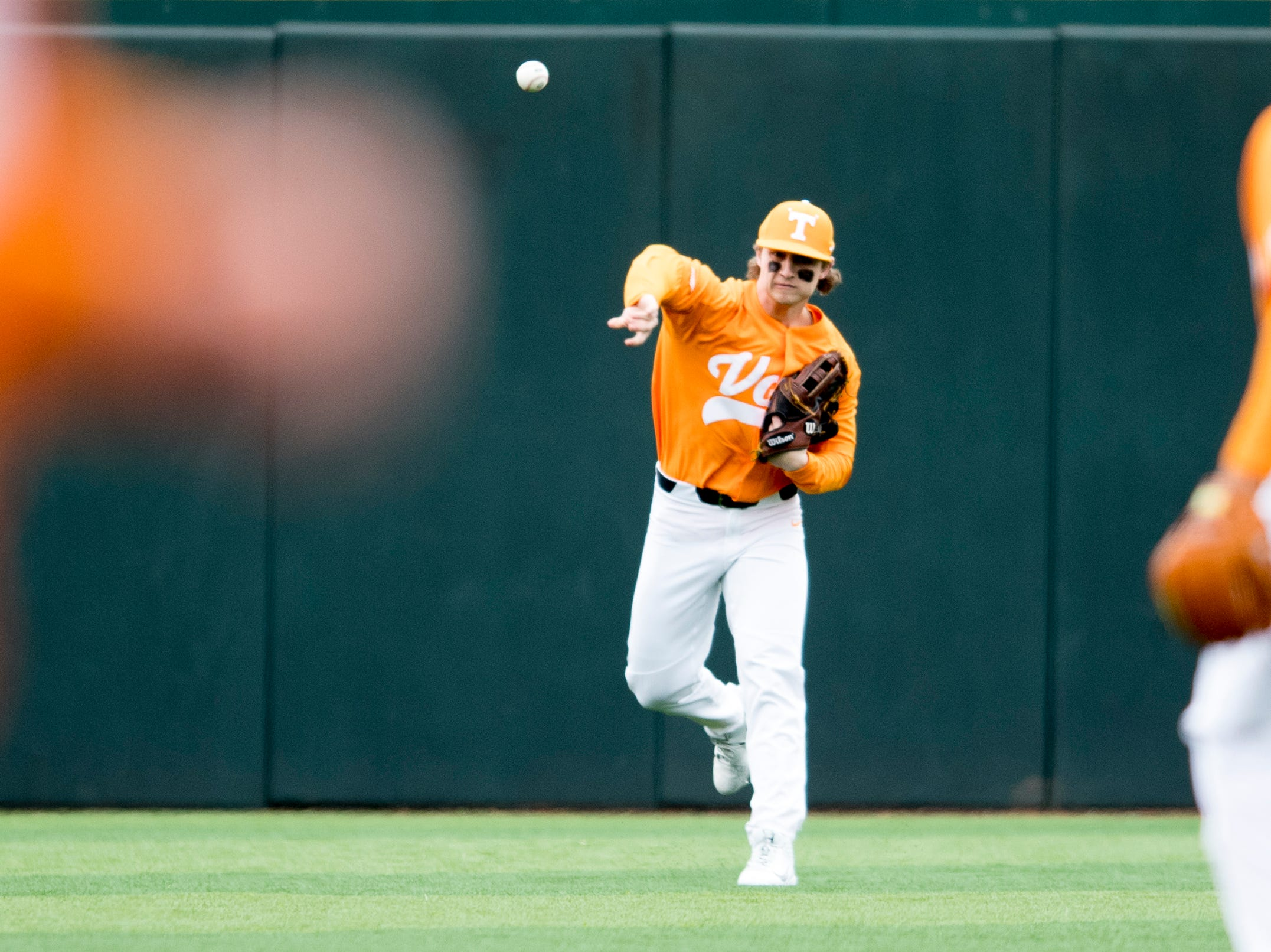 Tennessee outfielder Evan Russell (6) throws towards the infield during a Tennessee baseball home opener game against Appalachian State at Lindsey Nelson Stadium in Knoxville, Tennessee on Saturday, February 16, 2019.