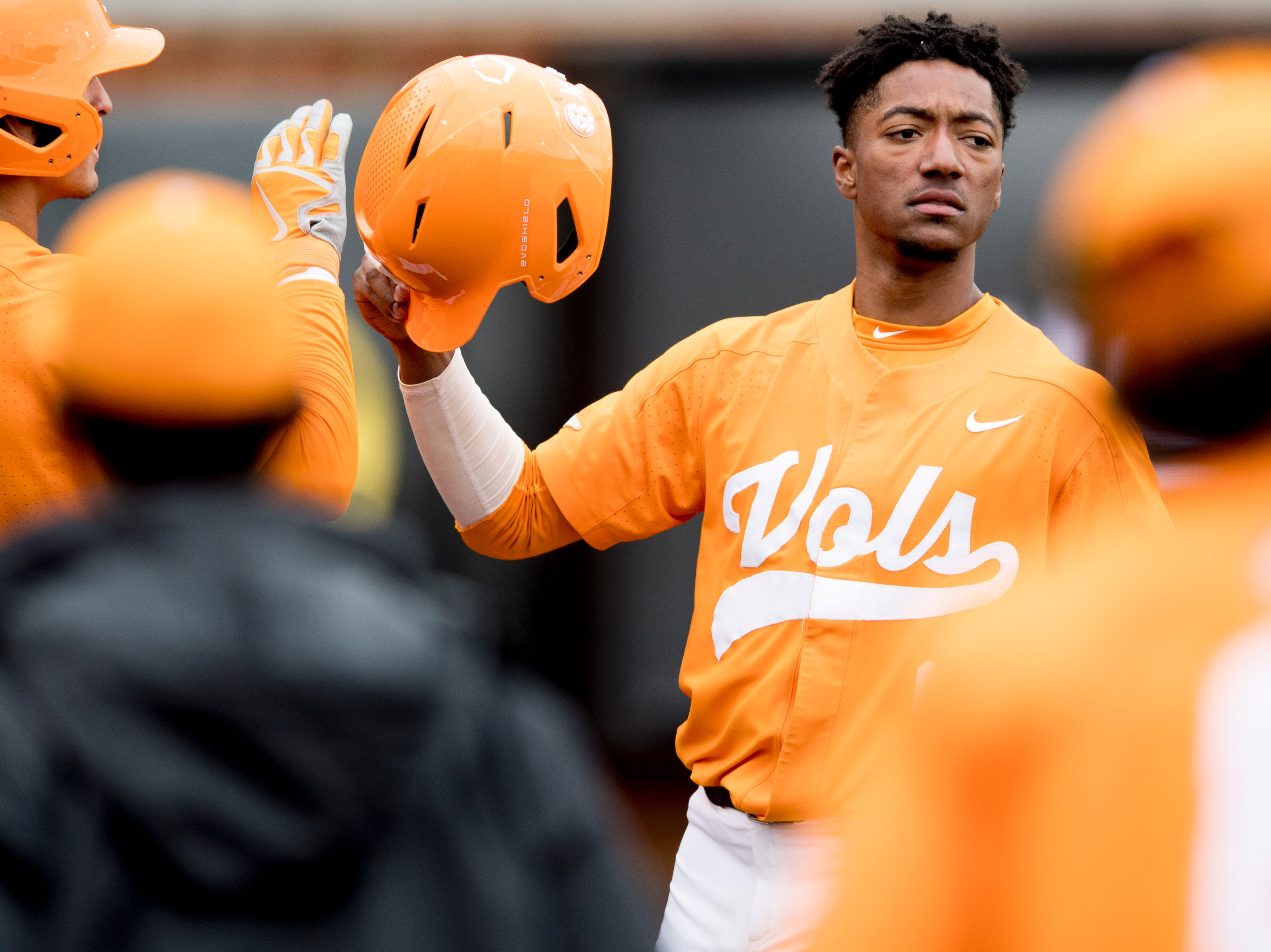 Tennessee outfielder/infielder Jay Charleston (4) is congratulated on his home run in the third inning during a Tennessee baseball home opener game against Appalachian State at Lindsey Nelson Stadium in Knoxville, Tennessee on Saturday, February 16, 2019.