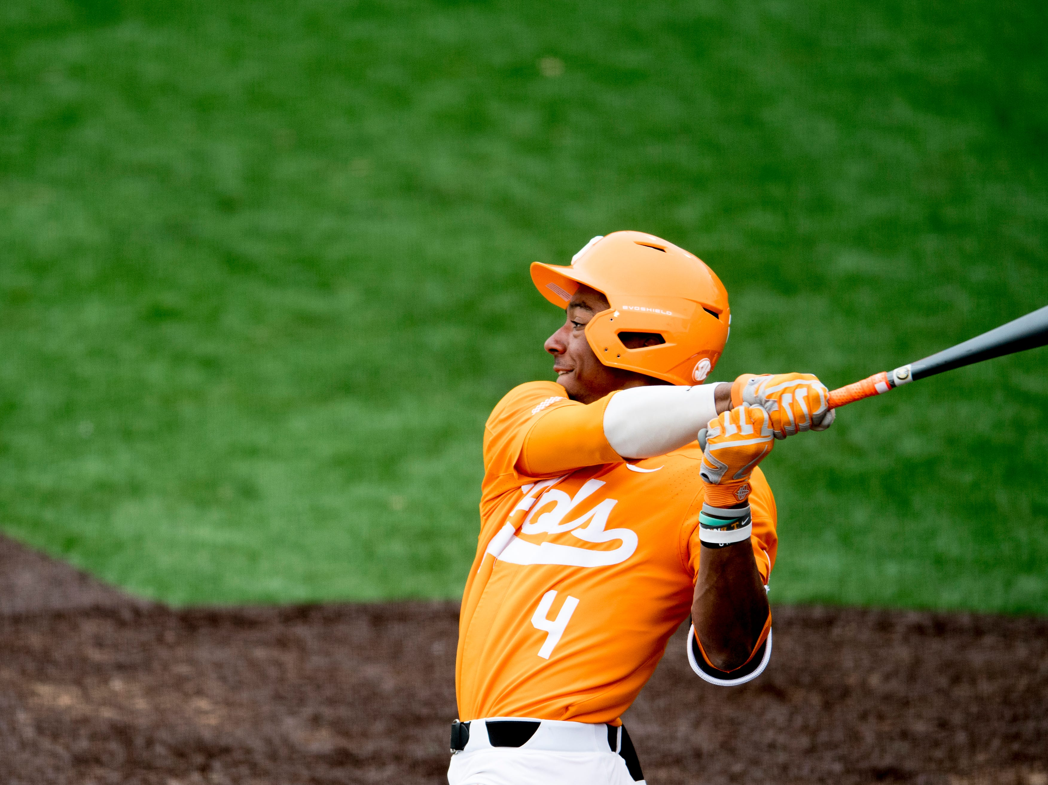 Tennessee outfielder/infielder Jay Charleston (4) swings during a Tennessee baseball home opener game against Appalachian State at Lindsey Nelson Stadium in Knoxville, Tennessee on Saturday, February 16, 2019.