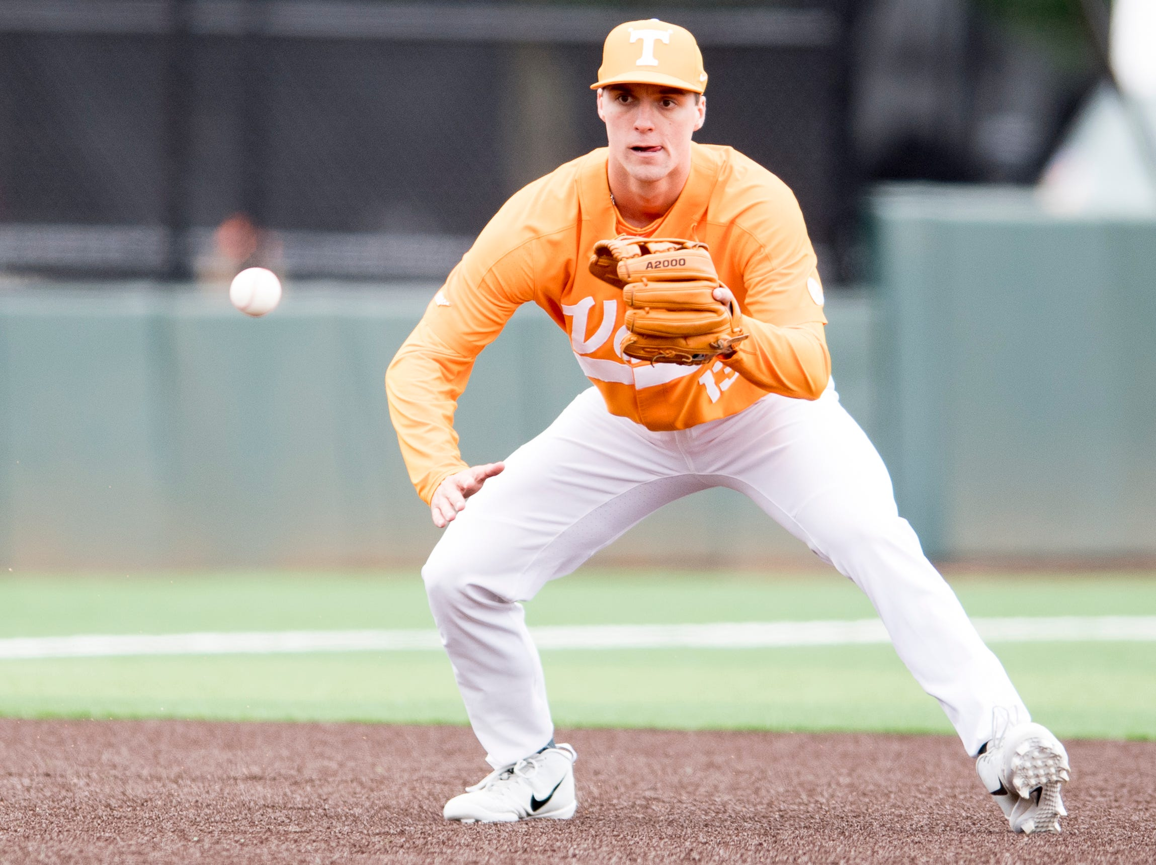 Tennessee infielder Andre Lipcius (13) eyes an incoming hit into left field during a Tennessee baseball home opener game against Appalachian State at Lindsey Nelson Stadium in Knoxville, Tennessee on Saturday, February 16, 2019.