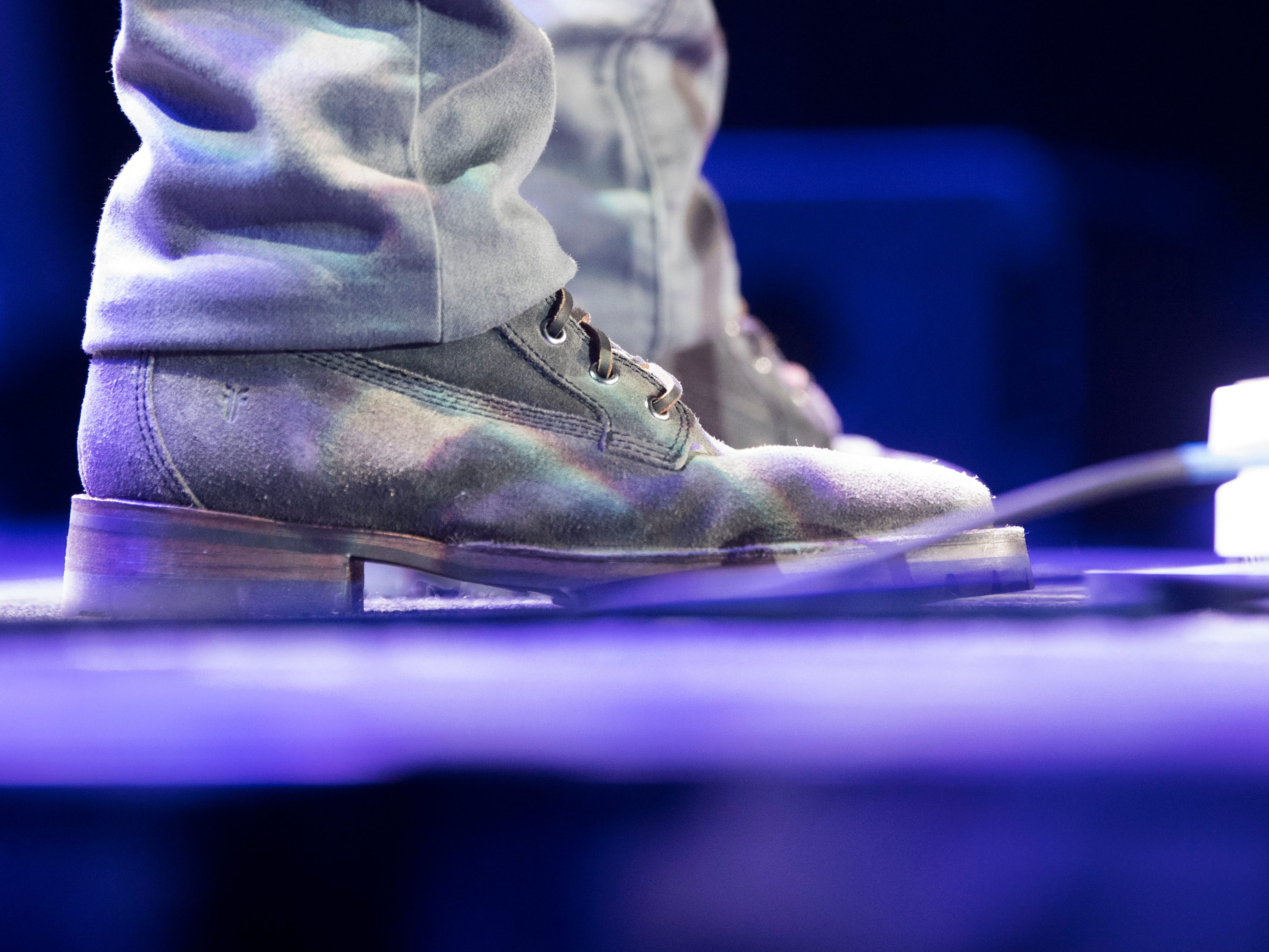 Opener Jameson Rodger's shoes are visible as he performs in Thompson-Boling Arena during a Luke Combs concert in Knoxville Friday, Feb. 15, 2019.