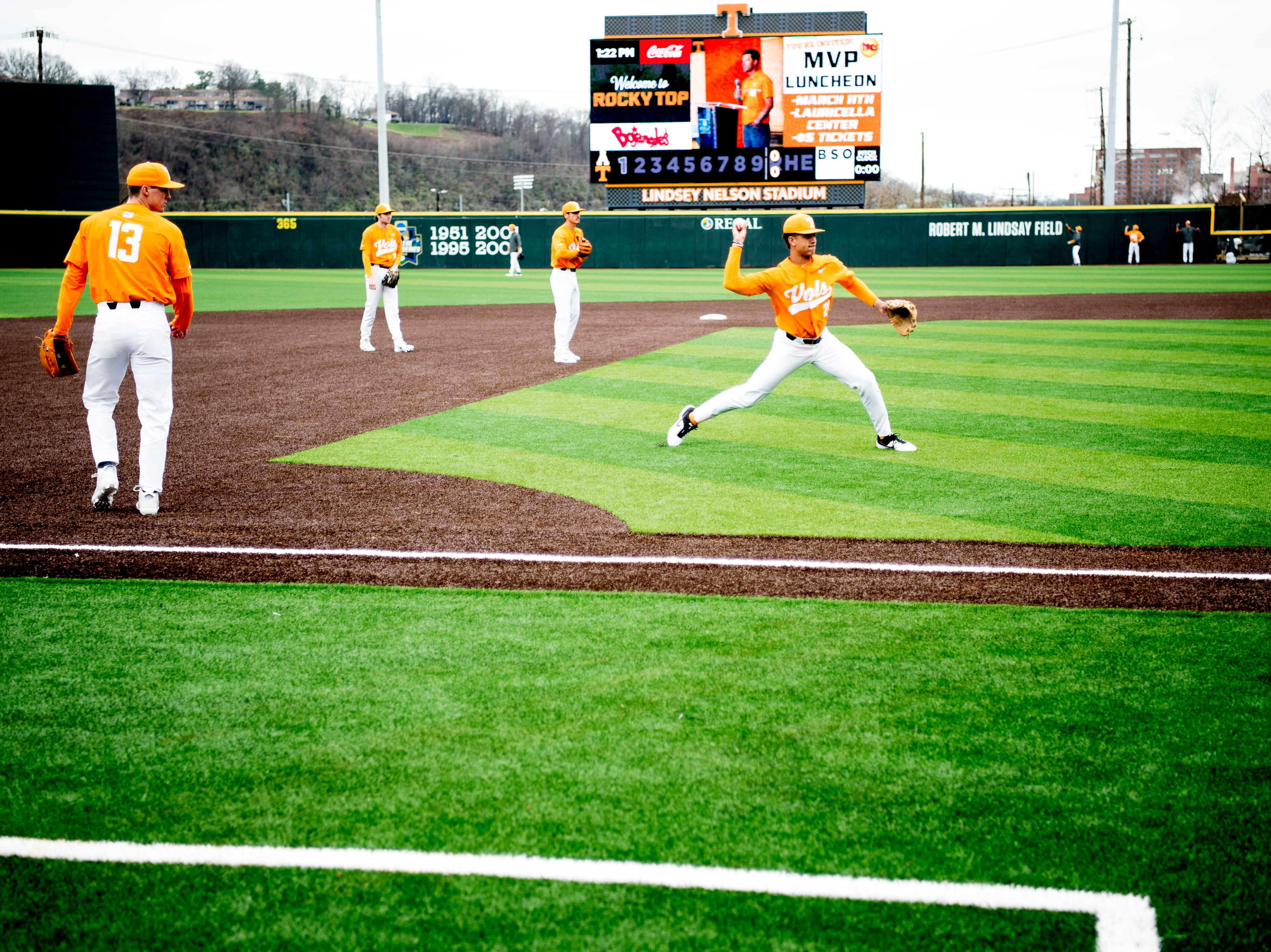 Tennessee players warm up on the all-new turf field at Lindsey Nelson Stadium in Knoxville, Tennessee on Saturday, February 16, 2019. The pitchers mound is the only part of the field that remains dirt.