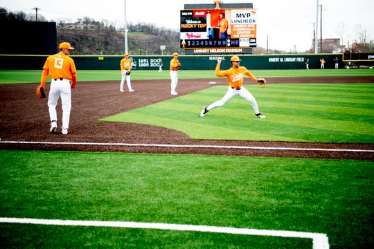 Tennessee players warm up on the new turf field Saturday at Lindsey Nelson Stadium.
