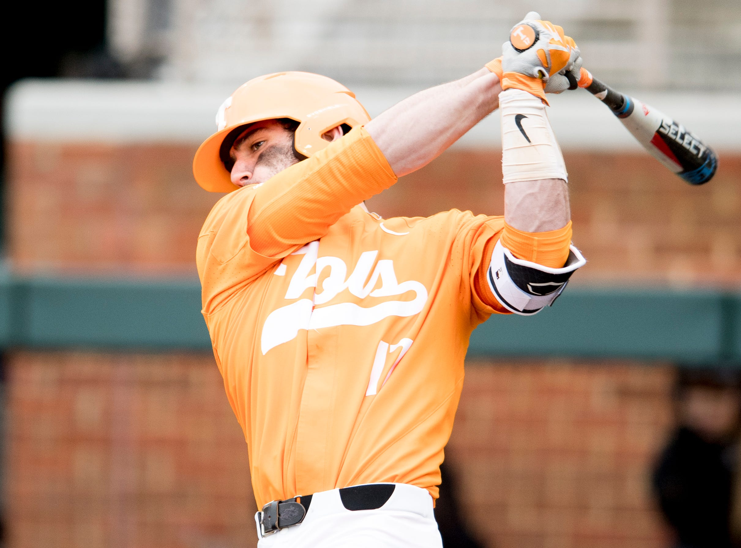 Tennessee catcher Connor Pavolony (17) swings during a Tennessee baseball home opener game against Appalachian State at Lindsey Nelson Stadium in Knoxville, Tennessee on Saturday, February 16, 2019.