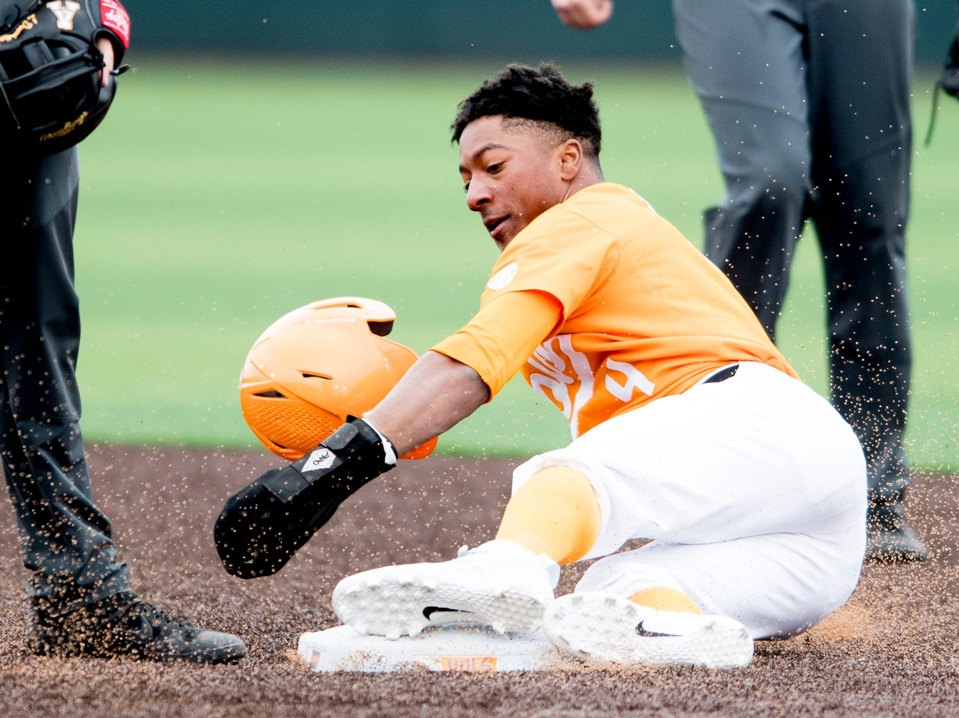 Tennessee outfielder/infielder Jay Charleston (4) loses his helmet while stealing second base during a Tennessee baseball home opener game against Appalachian State at Lindsey Nelson Stadium in Knoxville, Tennessee on Saturday, February 16, 2019.