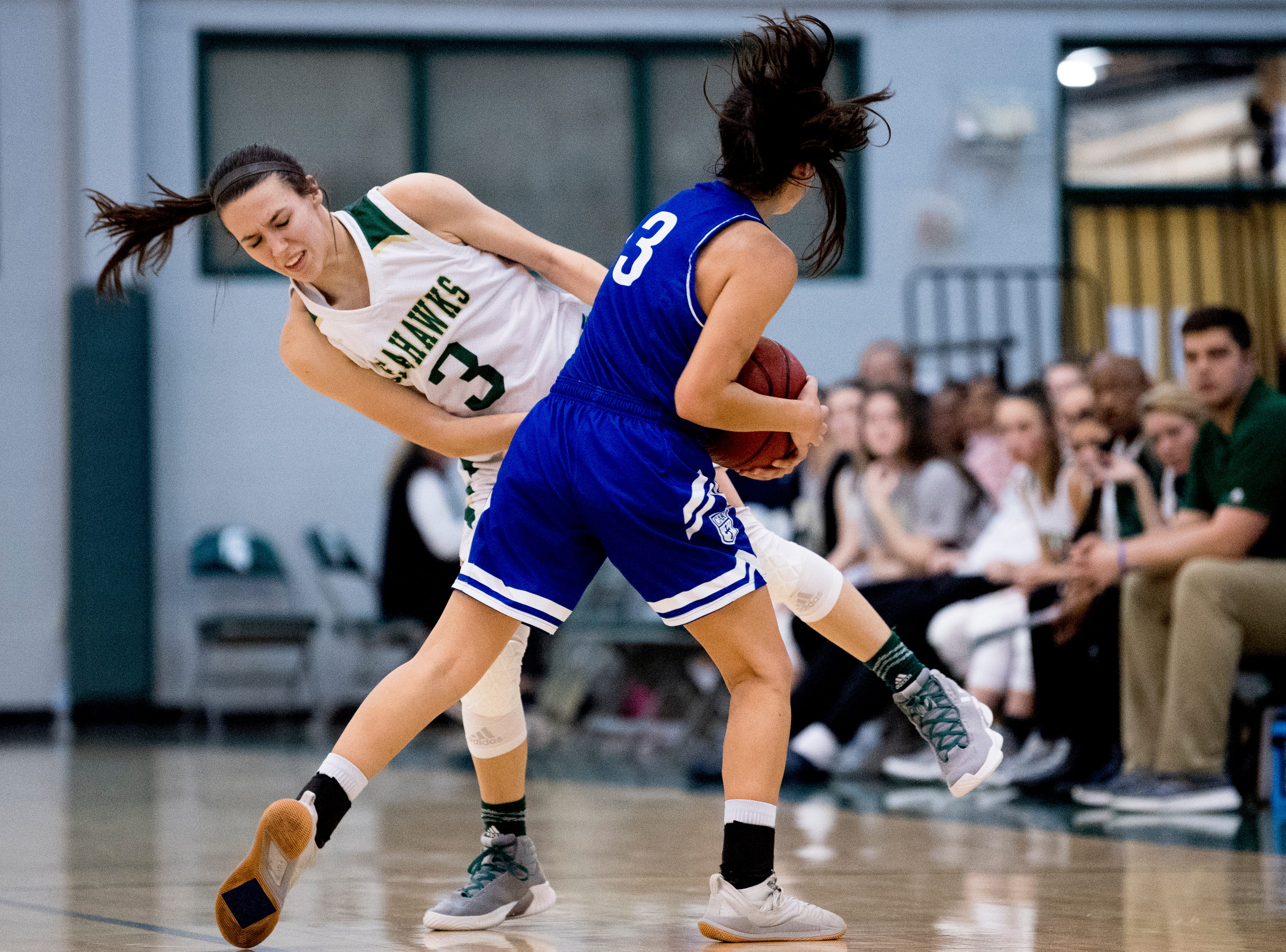Silverdale's Tessa Gibson (32) and CAK's Ellie Fussell (3) collide during a semifinal game between CAK and Silverdale at Webb School of Knoxville in Knoxville, Tennessee on Friday, February 15, 2019.