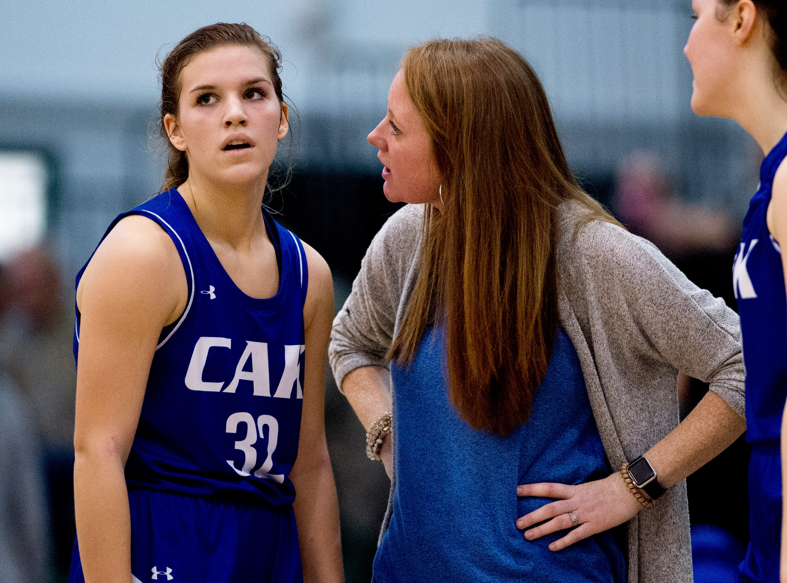 CAK's Head Abby Williams speaks with Mackenna Mozingo (32) during a semifinal game between CAK and Silverdale at Webb School of Knoxville in Knoxville, Tennessee on Friday, February 15, 2019.