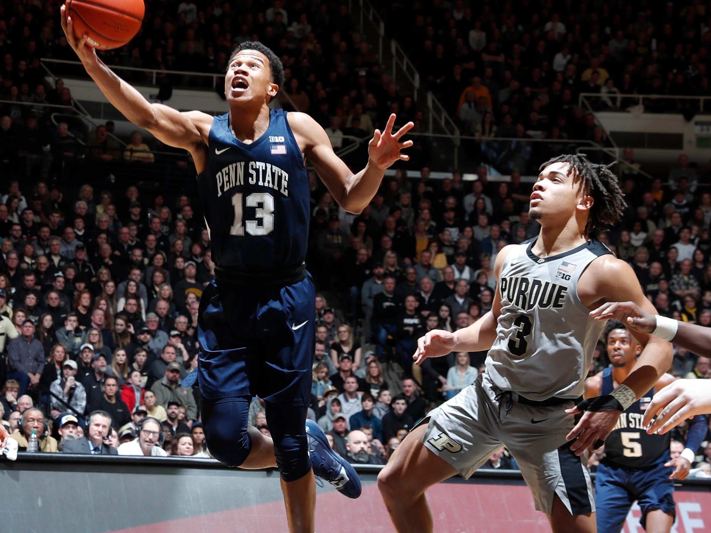 Feb 16, 2019; West Lafayette, IN, USA; Penn State Nittany Lions Rasir Bolton (13) takes a shot against Purdue Boilermakers guard Carsen Edwards (3) during the first half at Mackey Arena. Mandatory Credit: Brian Spurlock-USA TODAY Sports