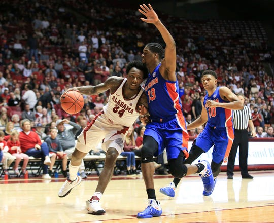 Feb 16, 2019; Tuscaloosa, AL, USA; Alabama Crimson Tide guard Tevin Mack (34) drives tithe basket against Florida Gators center Kevarrius Hayes (13) during the second half at Coleman Coliseum. Mandatory Credit: Marvin Gentry-USA TODAY Sports