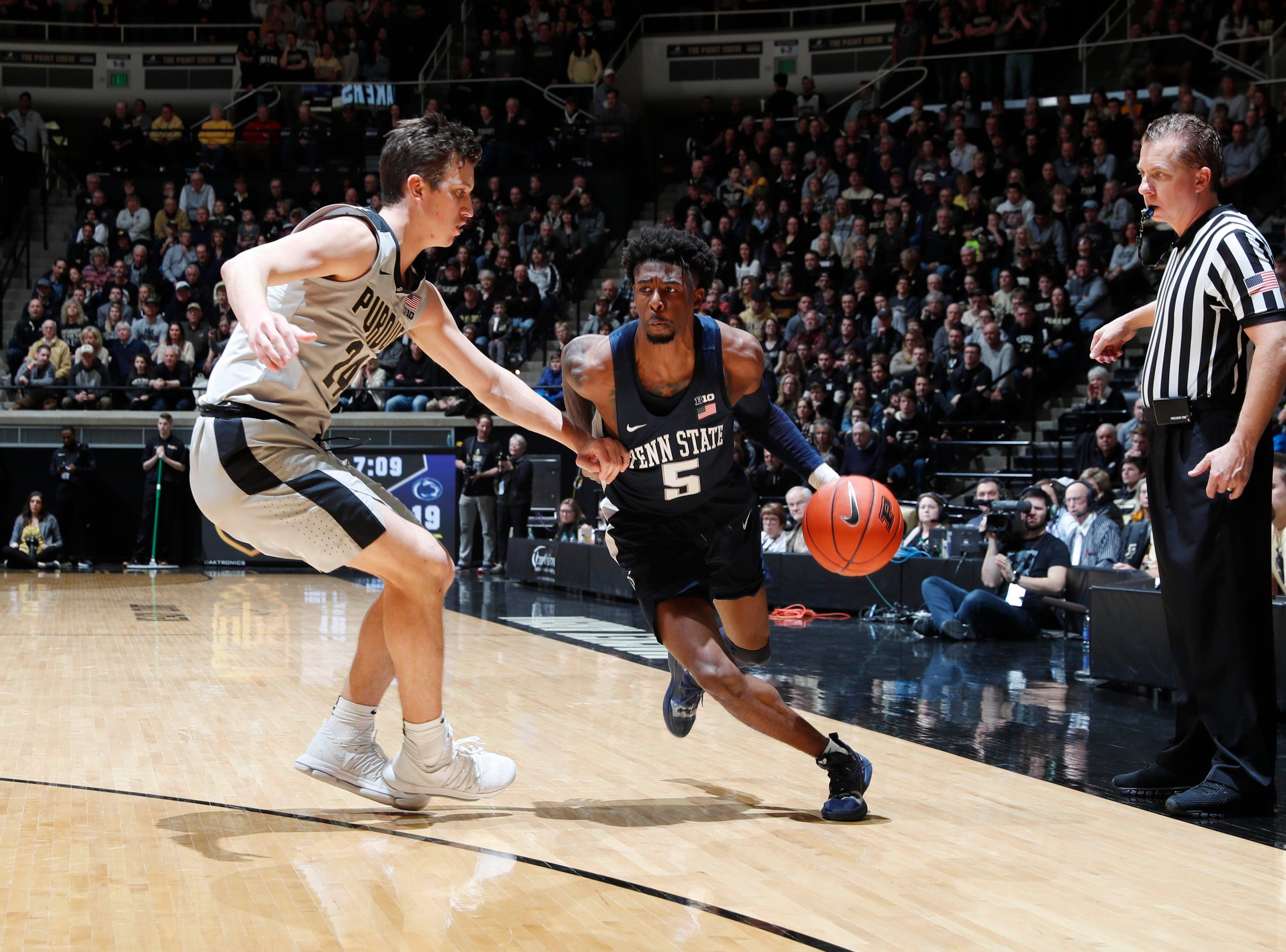 Feb 16, 2019; West Lafayette, IN, USA; Penn State Nittany Lions guard Jamari Wheeler (5) drives to the basket against Purdue Boilermakers forward Grady Eifert (24) during the first half at Mackey Arena. Mandatory Credit: Brian Spurlock-USA TODAY Sports
