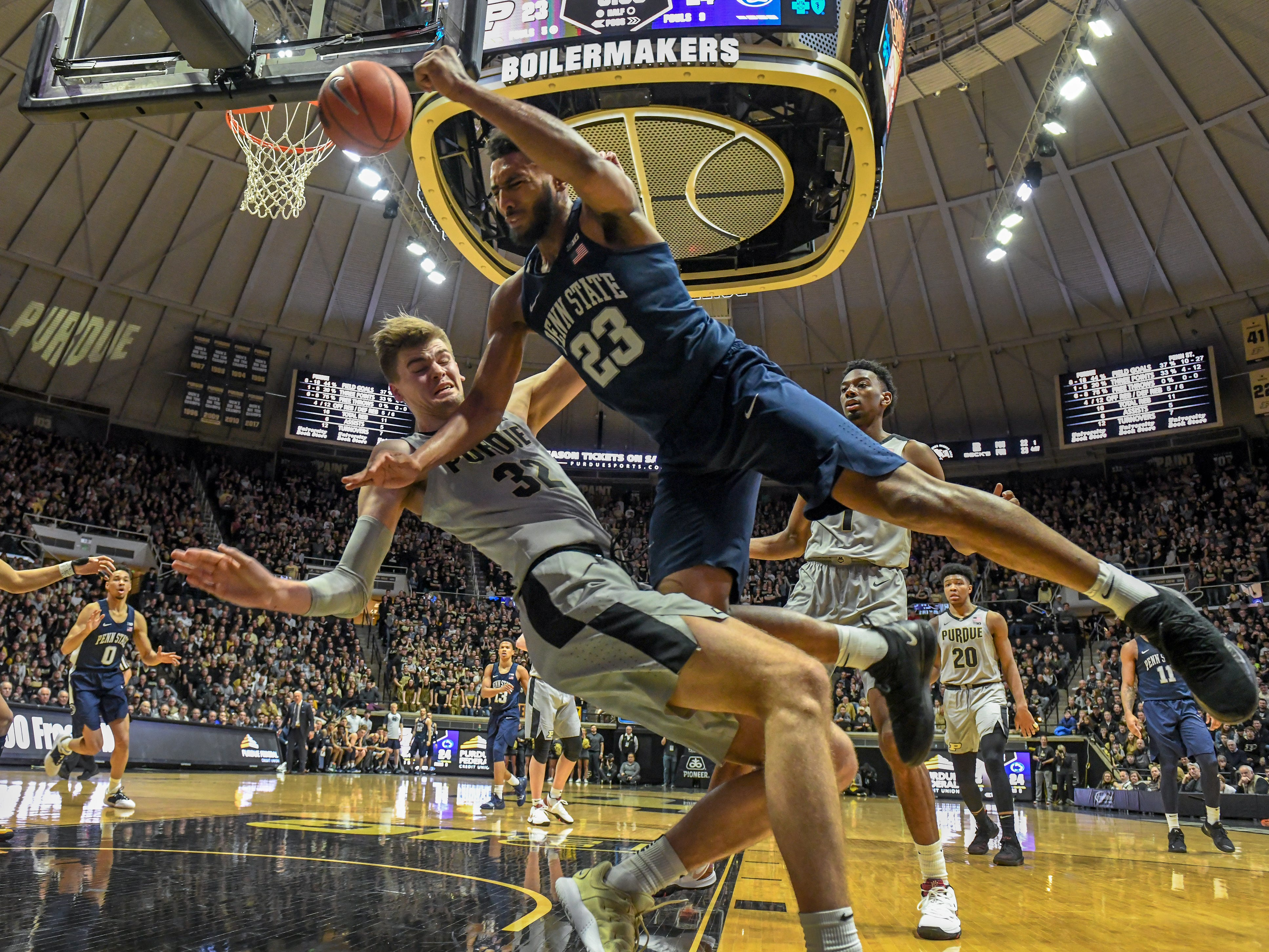 Purdue's Matt Haarms takes a charge as Penn State's Josh Reaves drives the baseline in the first half at Purdue on Saturday February 16, 2019.