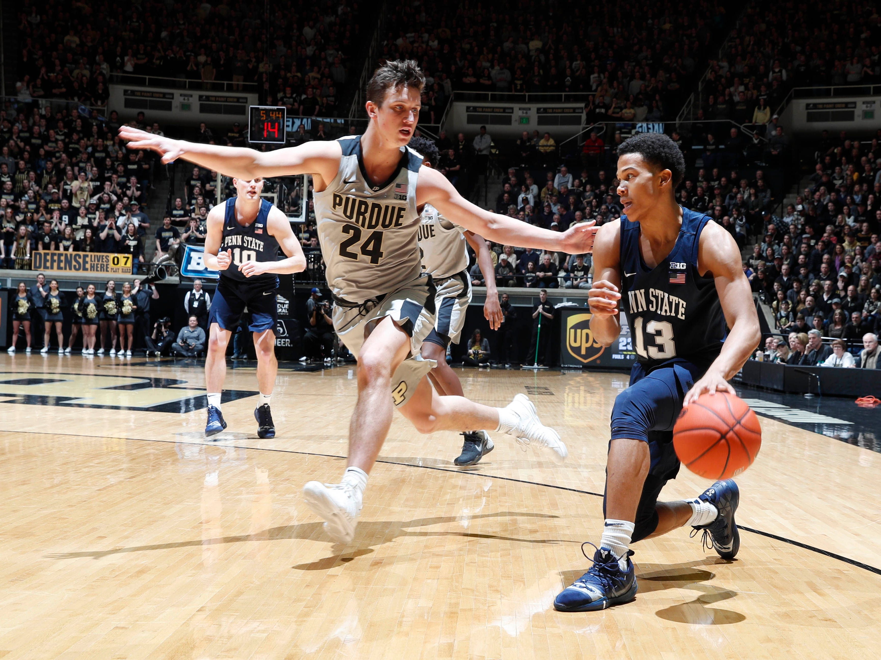 Feb 16, 2019; West Lafayette, IN, USA; Penn State Nittany Lions guard Rasir Bolton (13) drives to the basket against Purdue Boilermakers forward Grady Eifert (24) during the first half at Mackey Arena. Mandatory Credit: Brian Spurlock-USA TODAY Sports