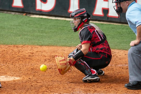 UL's Lexie Comeaux catches a low pitch as the Ragin' Cajuns take on Stephen F. Austin at Lamson Park on Saturday, Feb. 16, 2019.
