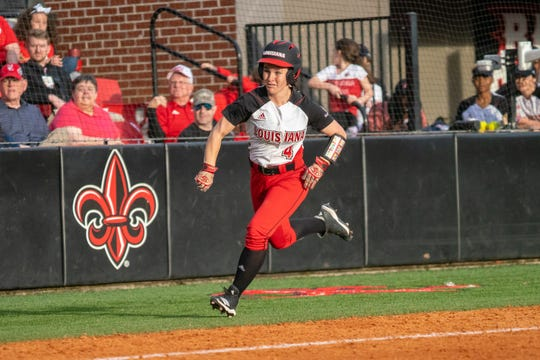UL's Keeli Milligan sprints toward home, as the Ragin' Cajuns take on Jackson State on Feb. 15 at Lamson Park.
