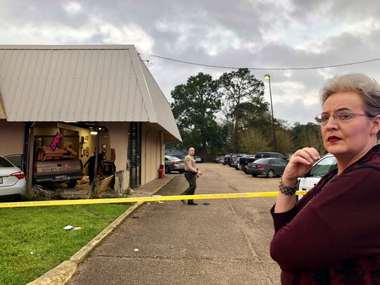 """Brenda Dudley was inside Princess Nails on Johnston Street when a truck entered the building Friday afternoon. """"It almost killed both of us,"""" she said about the woman next to her in the salon."""