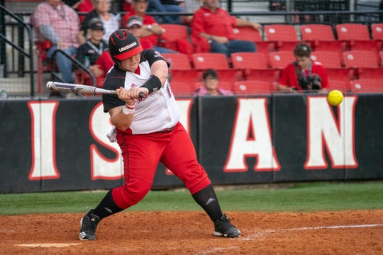 UL's Bailey Curry attempts to hit the oncoming pitch as the Ragin' Cajuns take on the Jackson State Tigers at Lamson Park on Feb. 15, 2019.