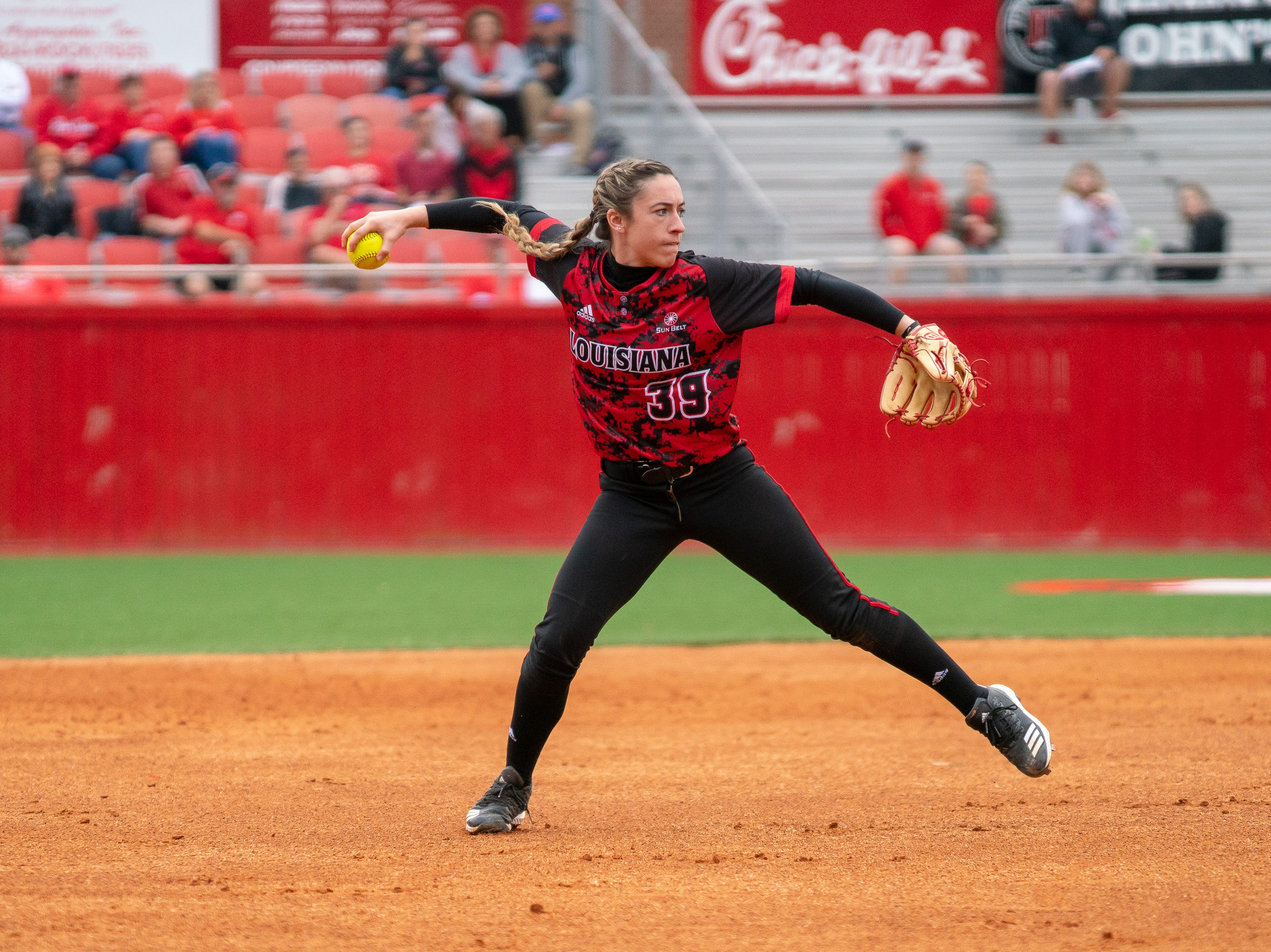 UL's Kara Gremillion throws the ball to first base as the Ragin' Cajuns take on Stephen F. Austin at Lamson Park on Saturday, Feb. 16, 2019.