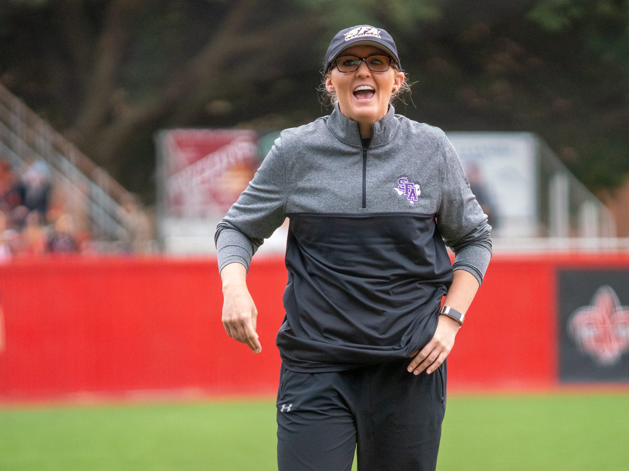 Stephen F. Austin's head softball coach Nicole Dickson yells out to her players from the sidelines as the Ragin' Cajuns take on Stephen F. Austin at Lamson Park on Saturday, Feb. 16, 2019.