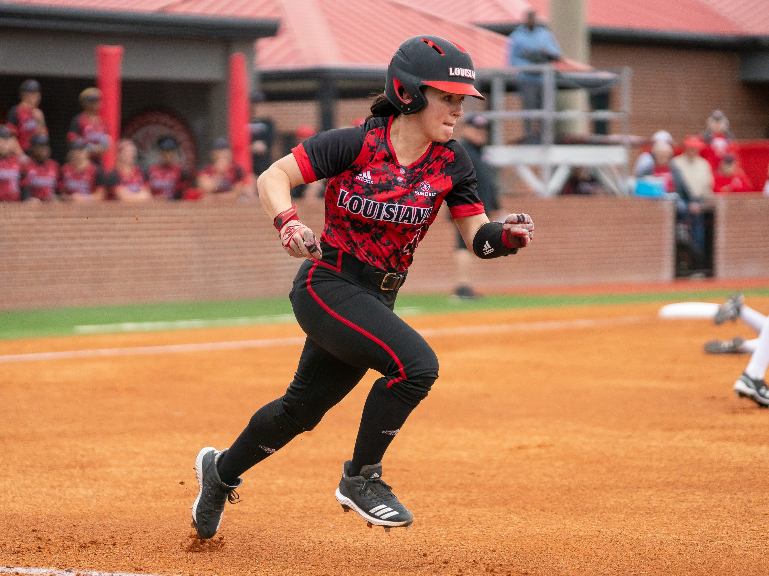UL's Keeli Milligan sprints to first base as the Ragin' Cajuns take on Stephen F. Austin at Lamson Park on Saturday, Feb. 16, 2019.