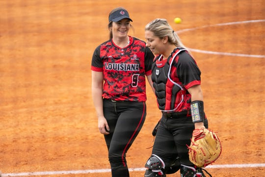 UL's Summer Ellyson (left) and Lexie Comeaux laugh after the end of an inning against Stephen F. Austin in the Cajuns' first game Saturday.