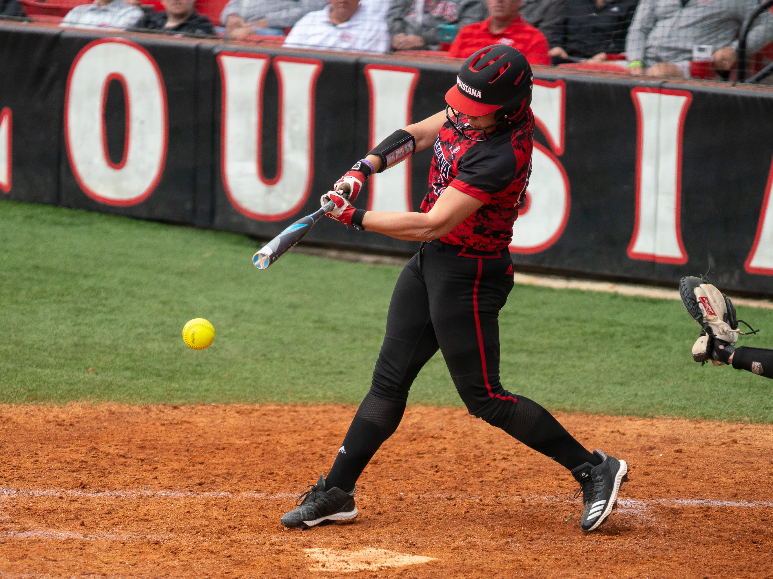 UL's Kourtney Gremillion hits a grounder as the Ragin' Cajuns take on Stephen F. Austin at Lamson Park on Saturday, Feb. 16, 2019.