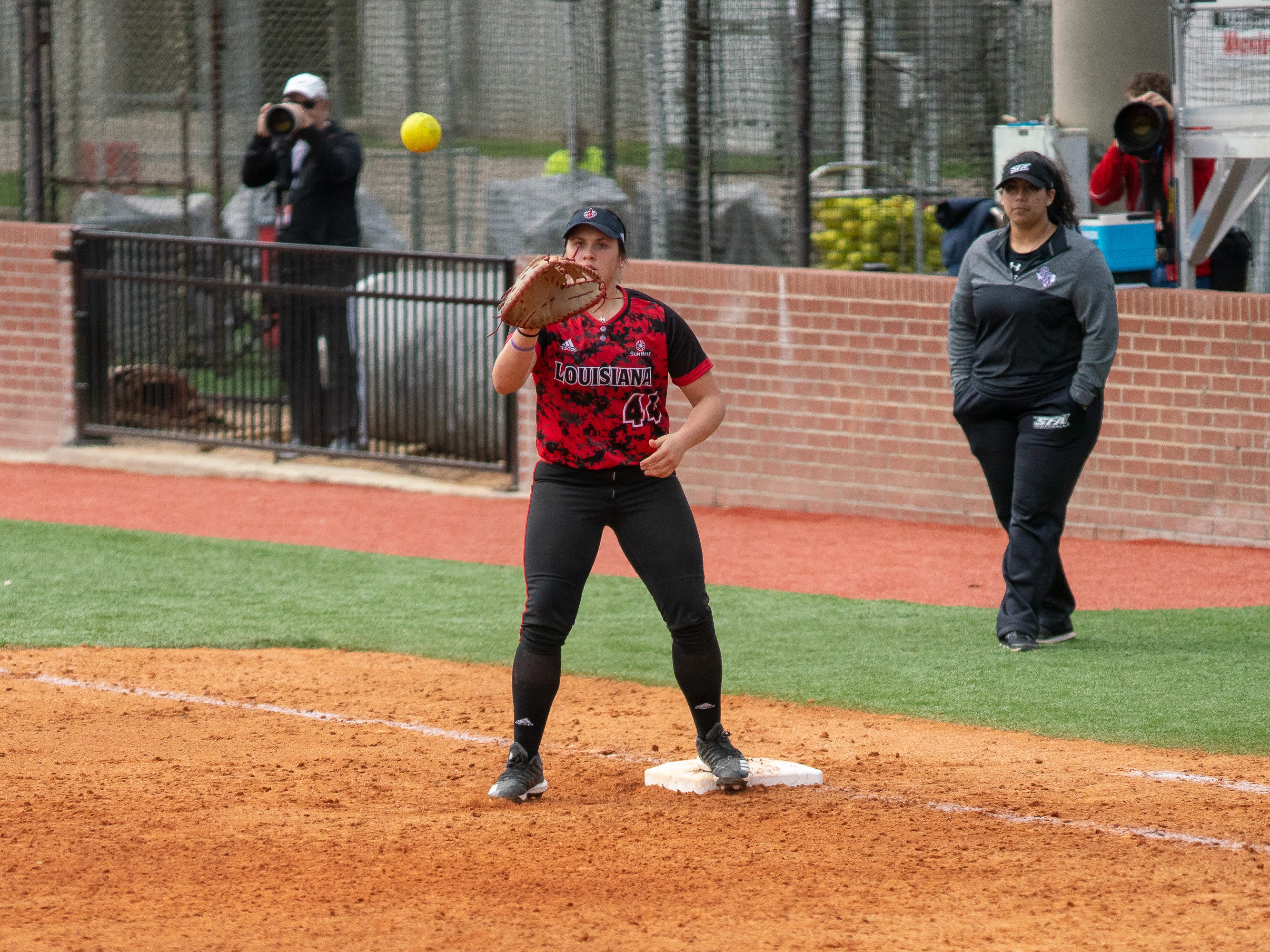 UL's Kourtney Gremillion catches the throw to first base as the Ragin' Cajuns take on Stephen F. Austin at Lamson Park on Saturday, Feb. 16, 2019.