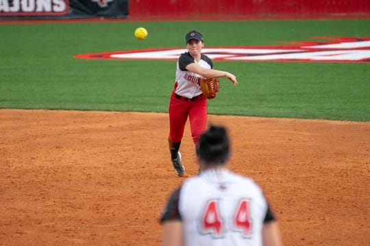 UL's Keeli Milligan throws the ball to first base during the Feb. 15 game against Jackson State at Lamson Park in Lafayette.
