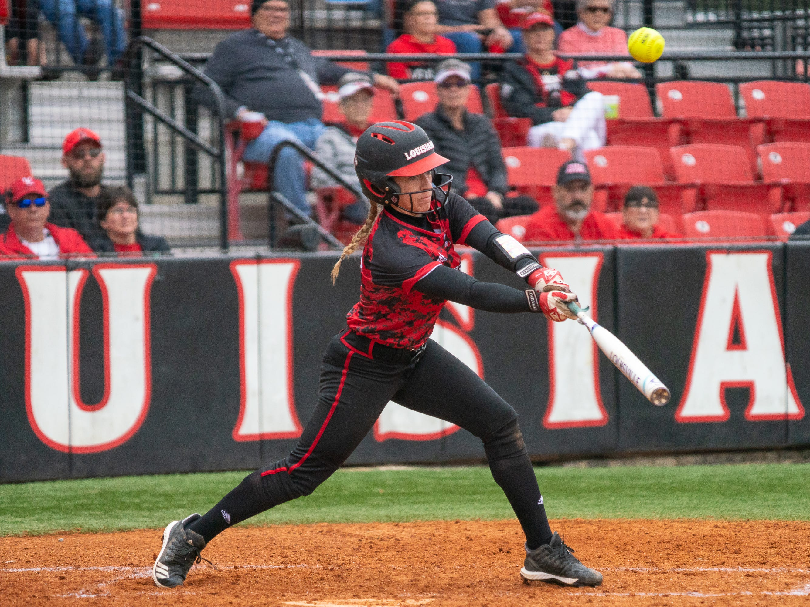 UL's Kara Gremillion hits the ball high as the Ragin' Cajuns take on Stephen F. Austin at Lamson Park on Saturday, Feb. 16, 2019.