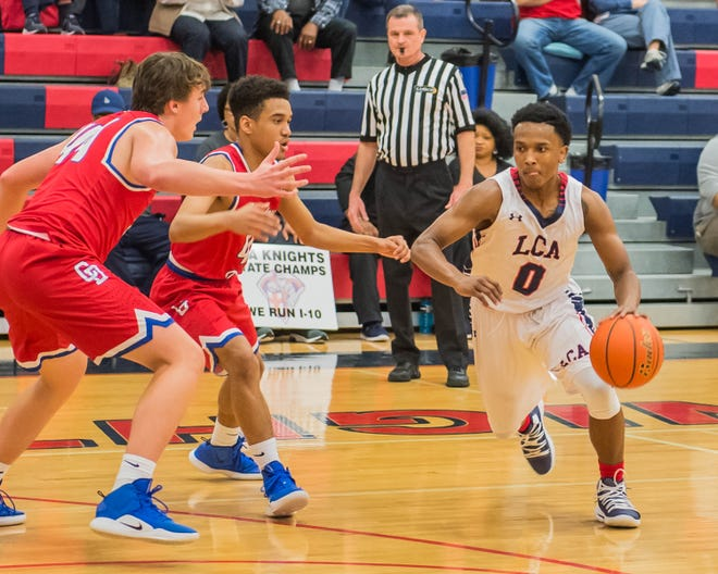 Lafayette Christian's T.J. Jones (0) works the ball up the court past two Country Day Defenders on Friday Feb. 15, 2019.