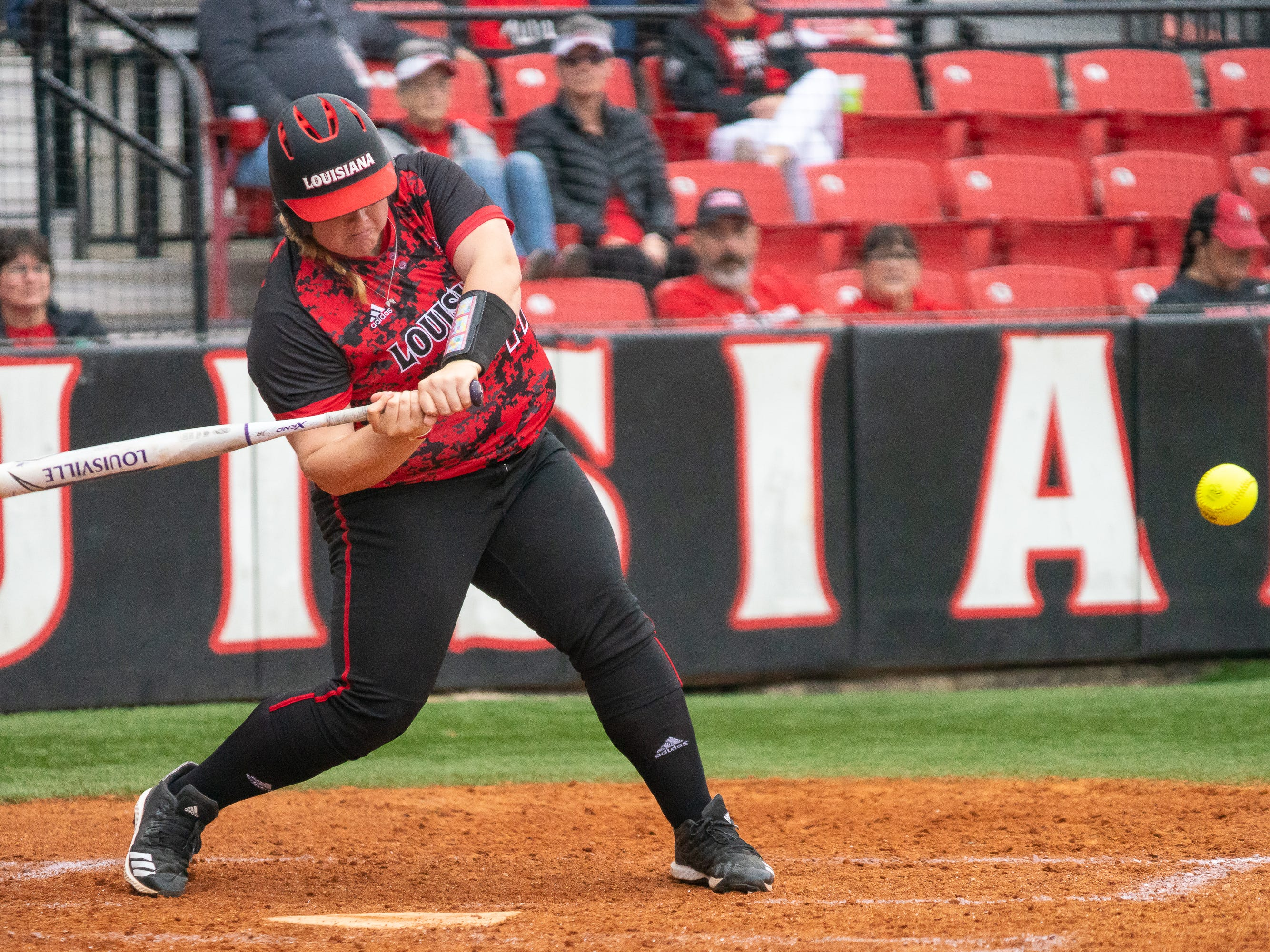 UL's Bailey Curry takes a swing at the pitch as the Ragin' Cajuns take on Stephen F. Austin at Lamson Park on Saturday, Feb. 16, 2019.