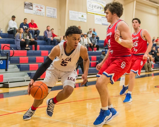 Lafayette Christian's Billy Francis (5) drives the baseline to the basket as LCA plays host to Metairie Country Day on Friday, Feb. 15, 2019.
