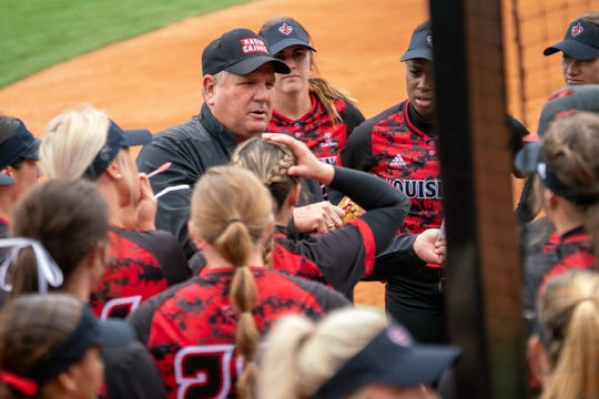 UL softball coach Gerry Glasco talks to his players outside of the dugout Feb. 16 against Stephen F. Austin at Lamson Park.