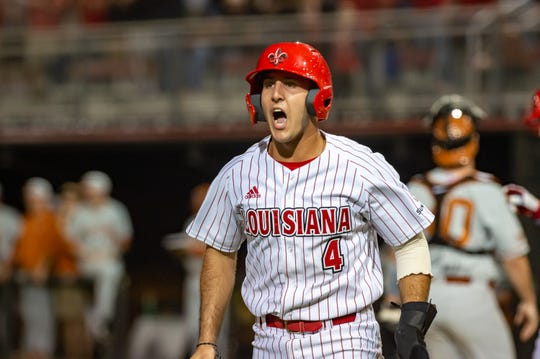 UL centerfielder Brennan Breaux scores a run against Texas in the Ragin' Cajuns' 2019 season-opener.