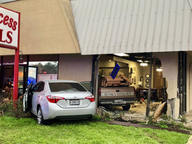 Injuries were reported Friday after a truck collided into Princess Nails while people were inside the Johnston Street salon.