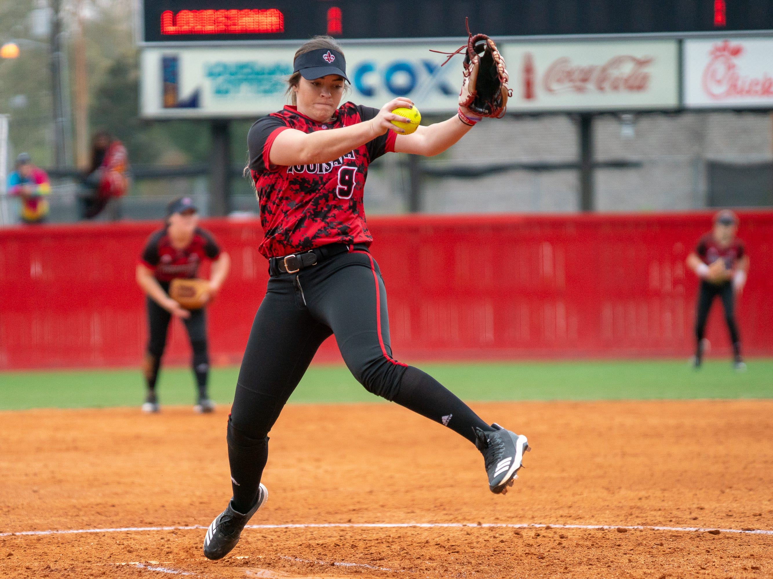 UL's Summer Ellyson pitches the ball as the Ragin' Cajuns take on Stephen F. Austin at Lamson Park on Saturday, Feb. 16, 2019.