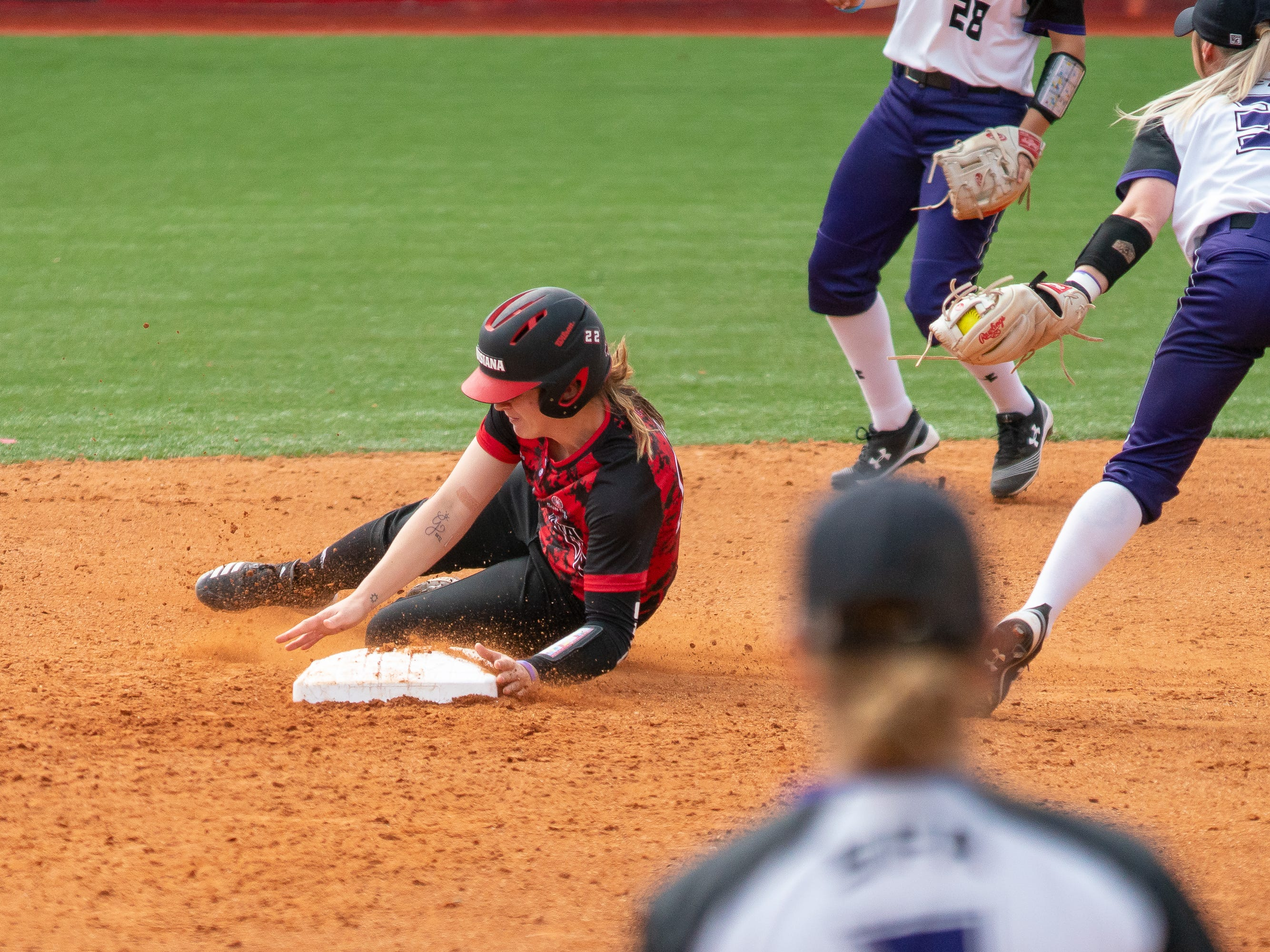 UL's Alissa Dalton gets tagged while stealing second base as the Ragin' Cajuns take on Stephen F. Austin at Lamson Park on Saturday, Feb. 16, 2019.