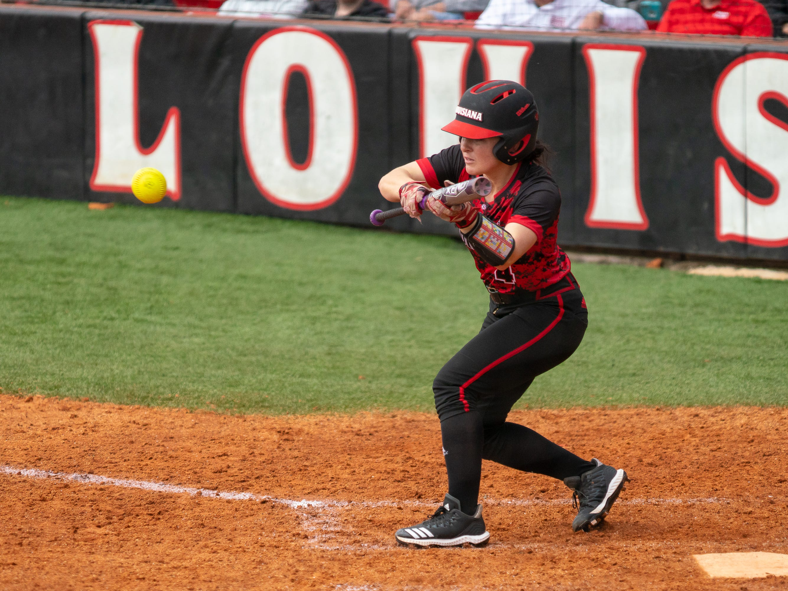 UL's Keeli Milligan attempts to hit the ball with a bunt as the Ragin' Cajuns take on Stephen F. Austin at Lamson Park on Saturday, Feb. 16, 2019.