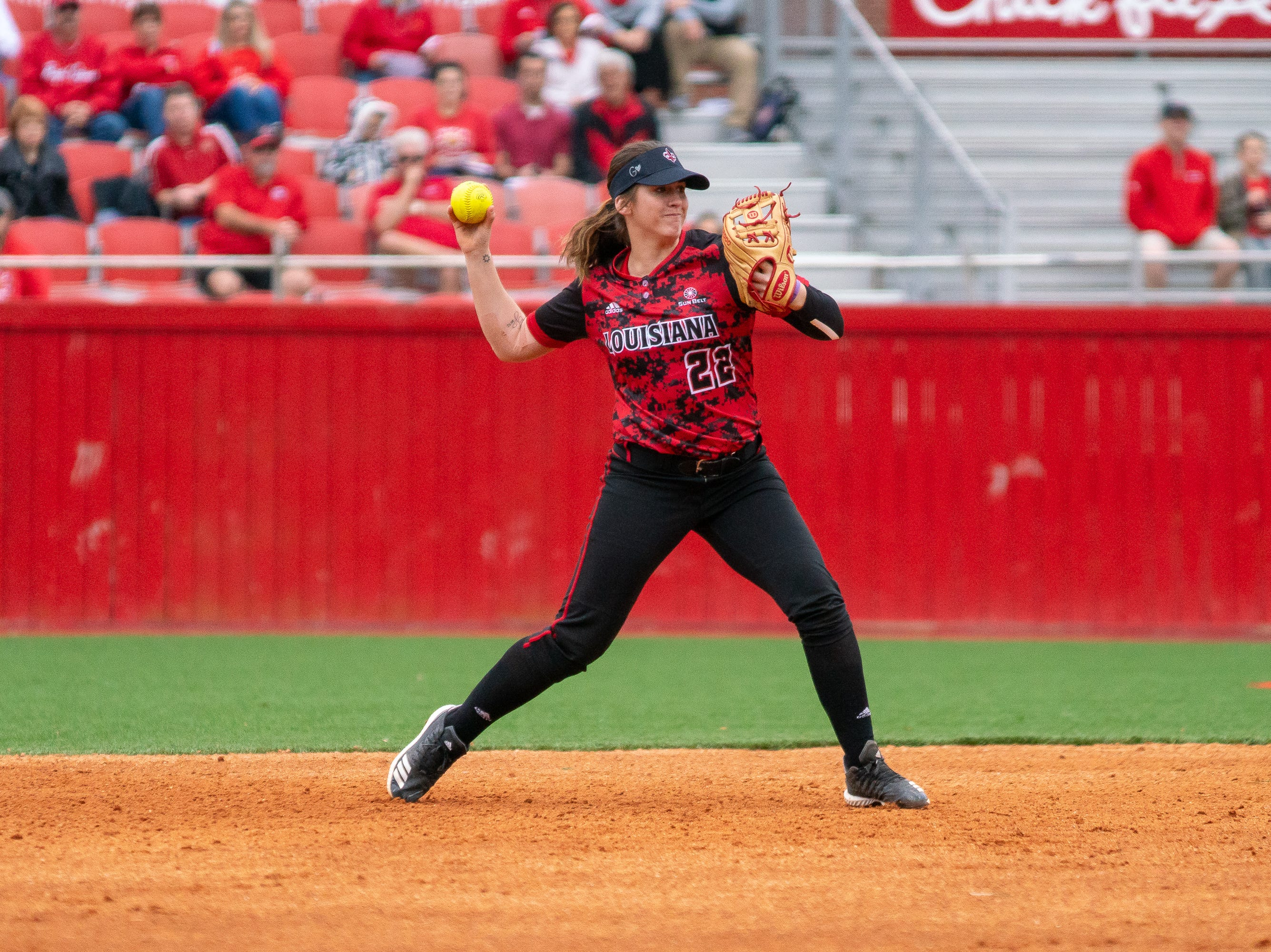 UL's Alissa Dalton throws to first base as the Ragin' Cajuns take on Stephen F. Austin at Lamson Park on Saturday, Feb. 16, 2019.