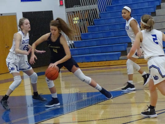 Lancaster's Brittney Azbell makes a move to the basket during the Lady Gales' 48-30 Division I tournament loss to Hilliard Davidson on Saturday.