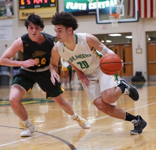Cobie Barnes dribbles against St. Xavier in a February game. Barnes is Floyd Central's leading scorer.