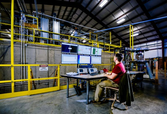 Niowave employee Andrew Schnepp at the control station at the company's isotope production facility located on Port Lansing Road.