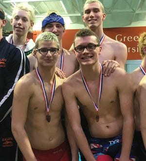 This 400 free relay crew of Kenton Cordrey, David Whittaker, Logan Rietschlin and Nic Derkez joins the boys 200 free relay in advancing for Ontario to the Division II state meet in Canton.