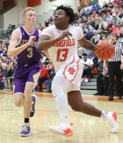 Mansfield Senior's Quan Hilory drives to the rim for two of his game-high 18 points in the Tygers' win over Lexington on Friday night.