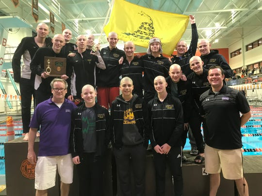 Brock Spurling's Lexington boys celebrate a repeat Division II district swim hampionship at Bowling Green.
