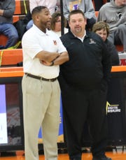 Mansfield Senior coach Marquis Sykes and Lexington coach Scott Hamilton talk before their last regular season meeting earlier this year. Sykes and Hamilton made their March Madness picks for the NCAA tournament.